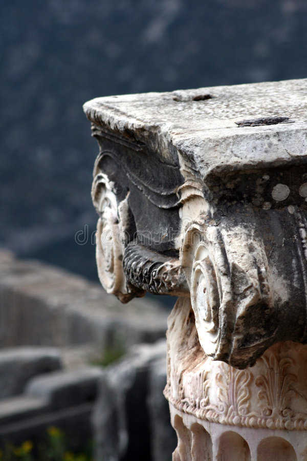 Ancient Greece. Detail from ancient greek Ionic column at Delphi royalty free stock photo