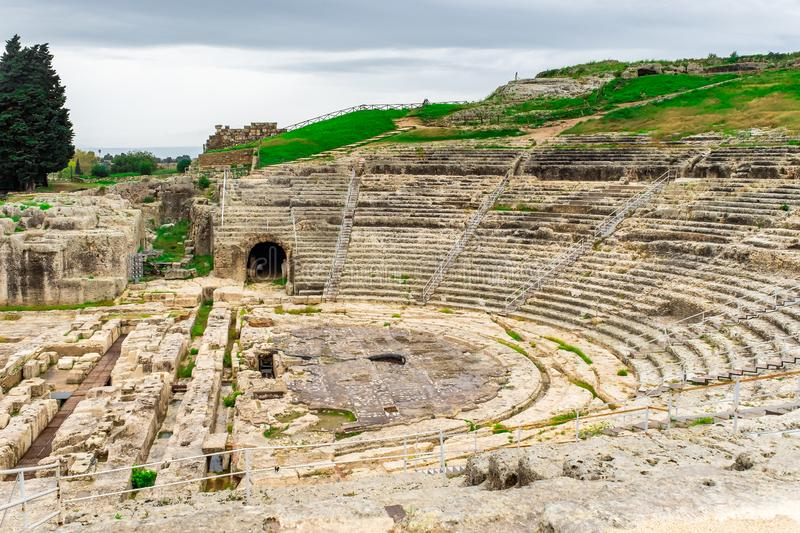 Ancient Greek amphitheater in historic city Syracuse on the island of Sicily royalty free stock photography