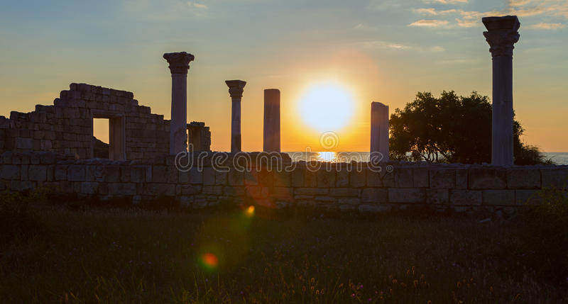 Ancient Greek basilica and marble columns in Chersonesus Taurica on the sunset background. Sevastopol, Crimea. Russia stock photography
