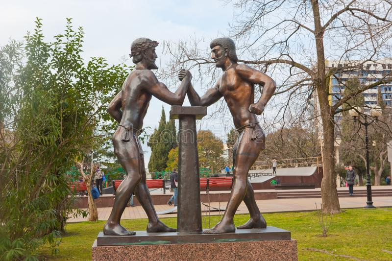 Ancient Greek Olympians. Arm wrestling. SOCHI, RUSSIA - FEBRUARY 11, 2014: Ancient Greek Olympians. Arm wrestling The sculptural composition royalty free stock photo