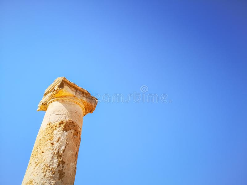 Ancient Greek pillar in stone against a blue sunny sky royalty free stock photography