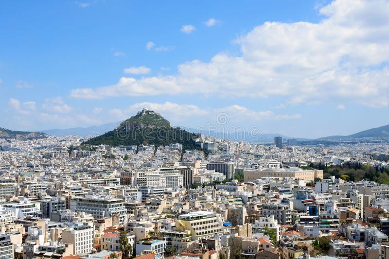 Ancient Greek ruins, ruins amidst lush green grass. Acropolis, Athens, Greece. Beautiful view of the capital of Greece - Athens from the slopes of the stock photos