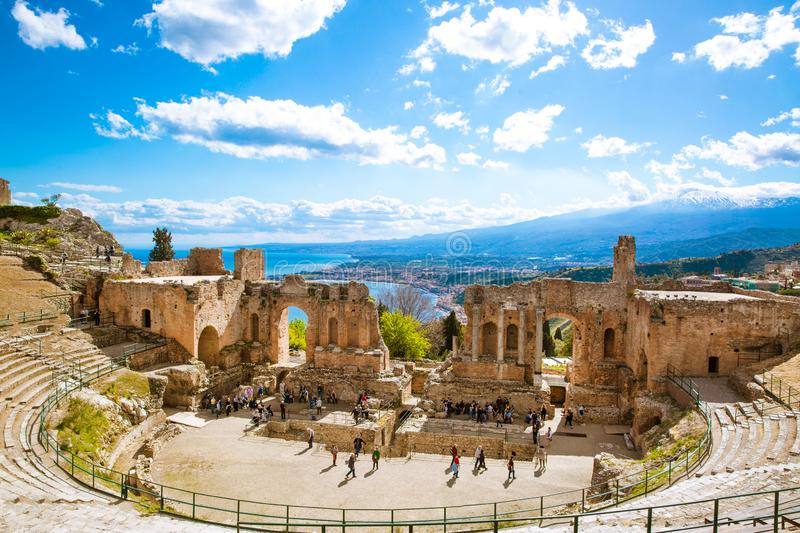 Ancient greek theatre and mediterranean sea panoramic view, Sicily, Italy. Ancient theatre, Etna vulcano and mediterranean sea panorama, bright summer day with royalty free stock photo