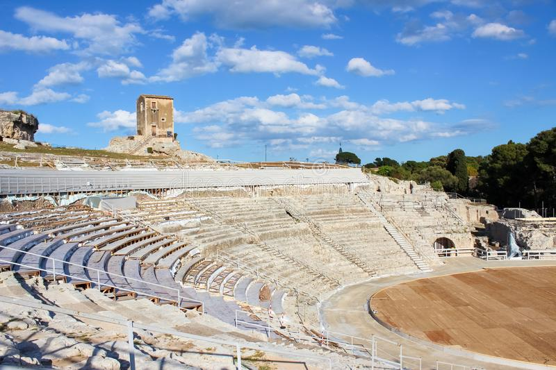 Ancient Greek Theatre of Syracuse in Sicily, Italy on a sunny day. Archaeological site, historical landmark. Popular tourist spot. Stage and tribunes ready for royalty free stock photos