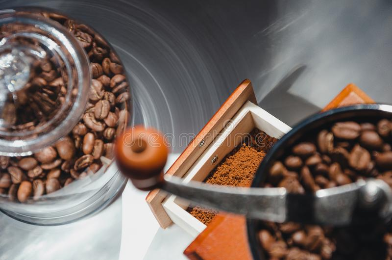 Ancient, hand-held coffee grinder with coffee beans.  royalty free stock photography