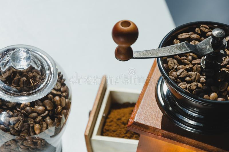 Ancient, hand-held coffee grinder with coffee beans.  royalty free stock photos