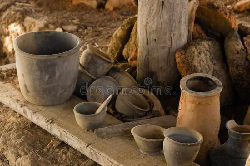 Ancient handmade clay pots, jugs, and other pottery royalty free stock photography