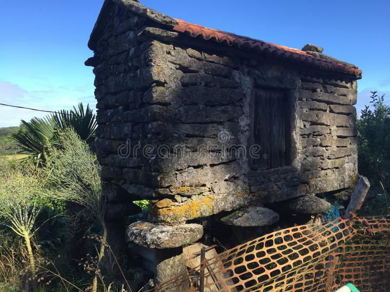 Ancient haunting stone house in the woods, in the Spanish trail. stock images