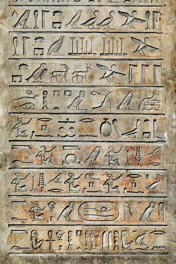 Ancient Hieroglyphic Script. Egiptian hieroglyph figures carved in sandstone stock photography