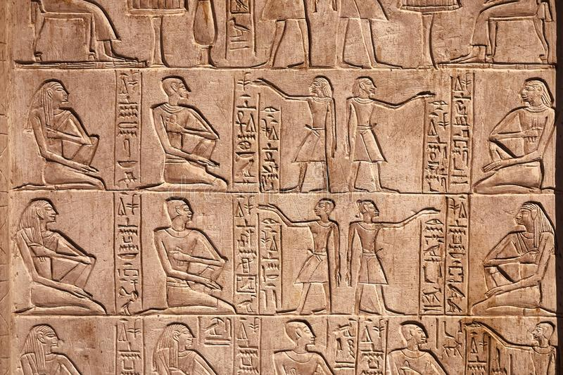 Ancient Hieroglyphic Script. Egiptian hieroglyphs carved in sandstone stock images