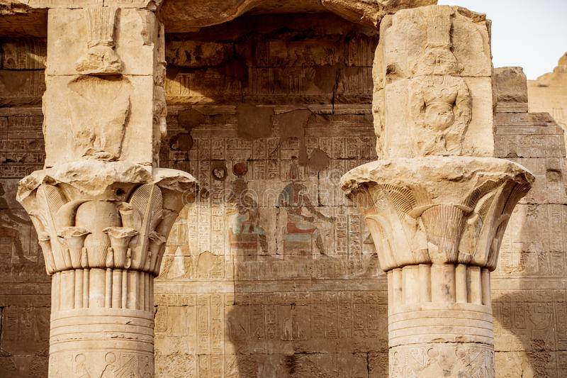 Ancient hieroglyphics still visible in colour on the exterior of Edfu Temple near Luxor Egypt royalty free stock photos