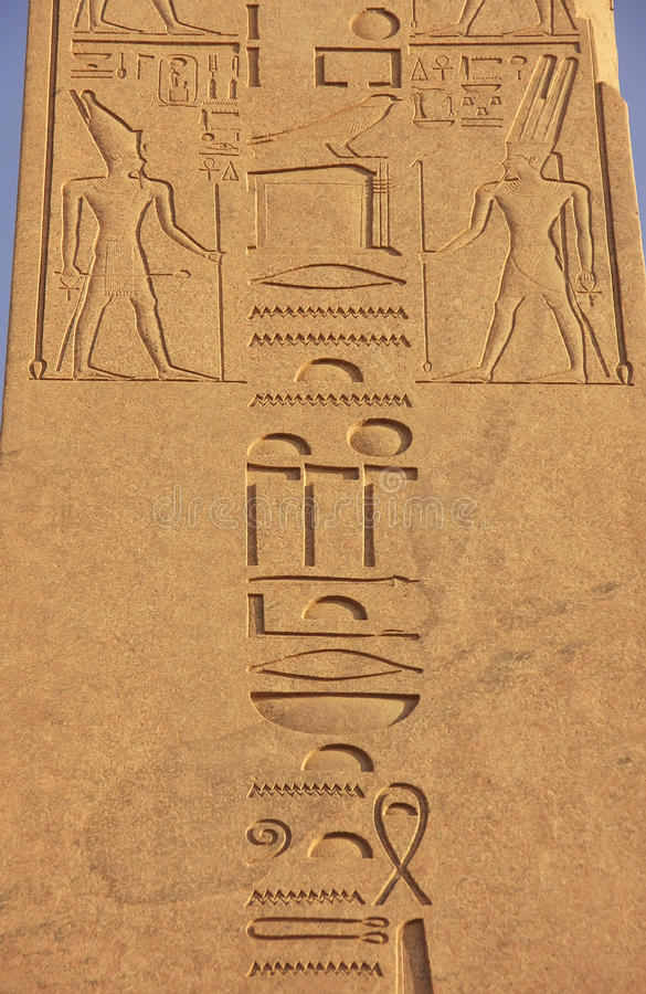 Ancient hieroglyphics on the walls of Karnak temple complex, Lux. Or, Egypt royalty free stock photo