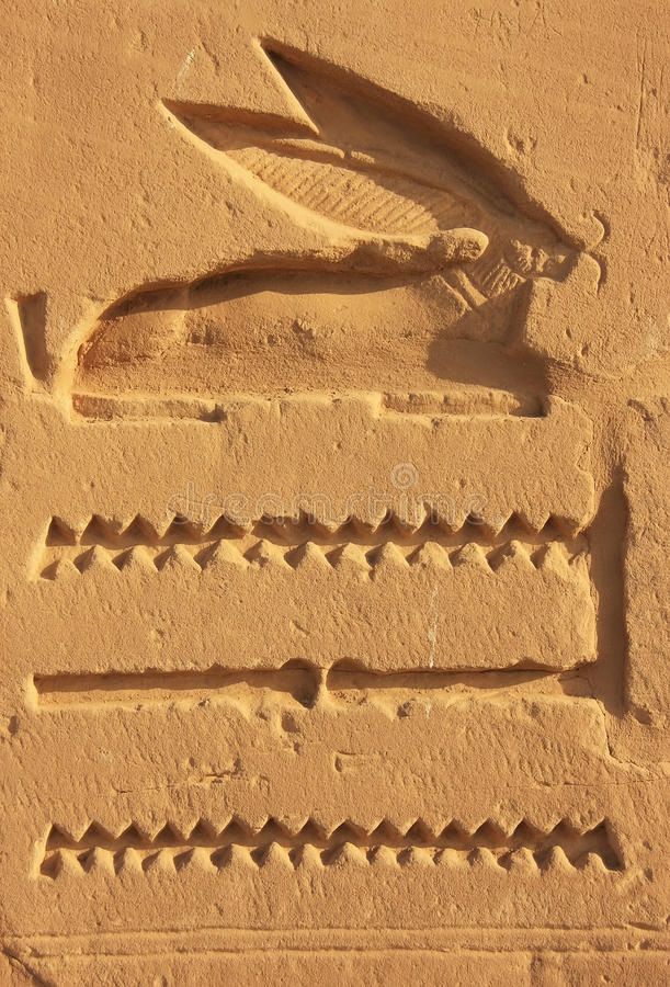 Ancient hieroglyphics on the walls of Karnak temple complex, Lux. Or, Egypt royalty free stock image