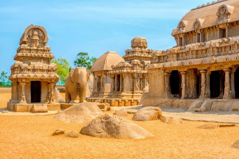 Ancient Hindu monolithic Indian sculptures rock-cut architecture. Pancha Rathas - Five Rathas, Mahabalipuram, Tamil Nadu, South India royalty free stock photography
