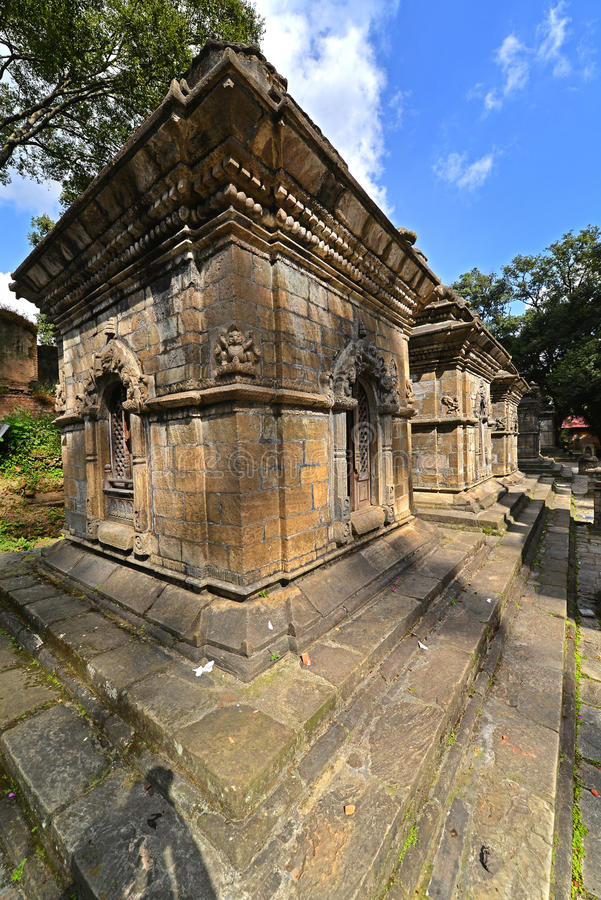 Ancient Hindu temple in Pashupatinath before the earthquake that. PASHUPATINATH - OCTOBER 10: Ancient Hindu temple, now collapsed after the earthquake that hit stock image