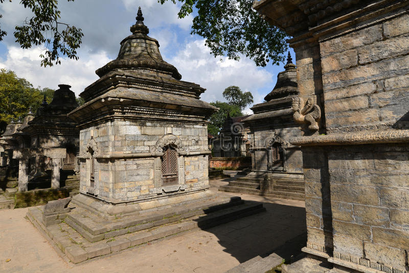 Ancient Hindu temple in Pashupatinath before the earthquake that. PASHUPATINATH - OCTOBER 10: Ancient Hindu temple, now collapsed after the earthquake that hit stock photo