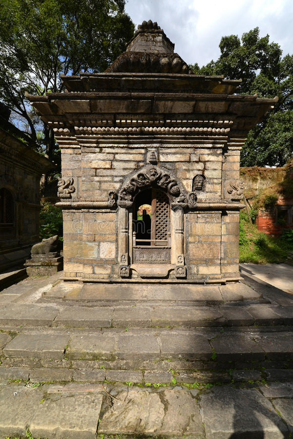 Ancient Hindu temple in Pashupatinath before the earthquake that. PASHUPATINATH - OCTOBER 10: Ancient Hindu temple, now collapsed after the earthquake that hit stock images