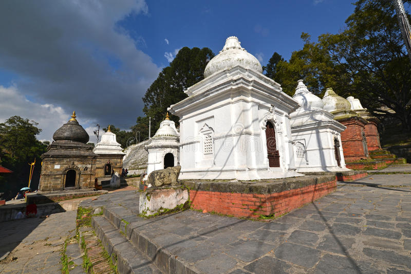 Ancient Hindu temple in Pashupatinath before the earthquake that. PASHUPATINATH - OCTOBER 10: Ancient Hindu temple, now collapsed after the earthquake that hit royalty free stock images