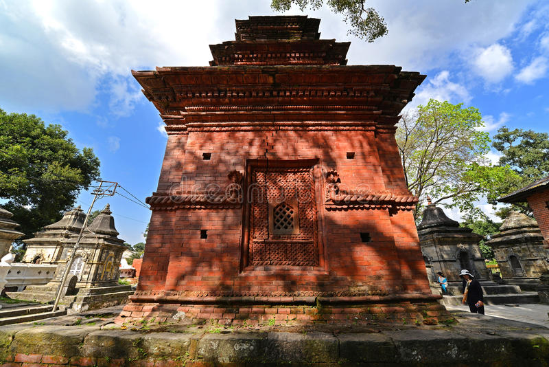 Ancient Hindu temple in Pashupatinath before the earthquake that. PASHUPATINATH - OCTOBER 10: Ancient Hindu temple, now collapsed after the earthquake that hit royalty free stock photography