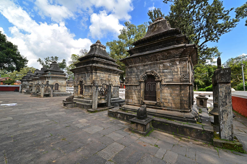 Ancient Hindu temple in Pashupatinath before the earthquake that. PASHUPATINATH - OCTOBER 10: Ancient Hindu temple, now collapsed after the earthquake that hit royalty free stock photo