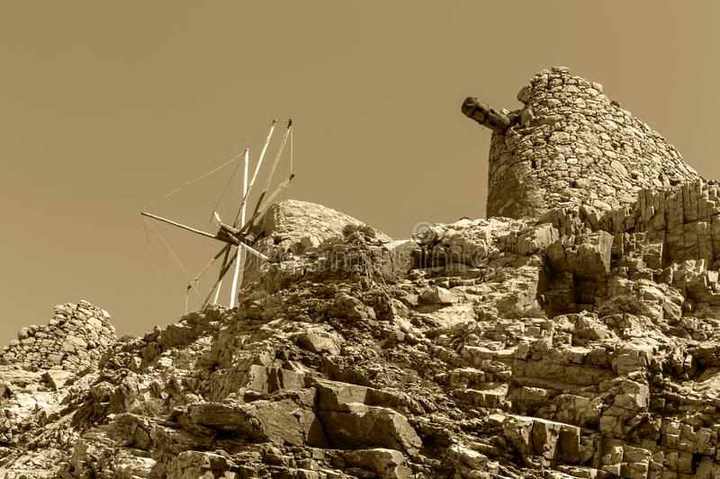Ancient, historic, famous, dilapidated stone windmills on a sunny day Lassithi area, island Crete, Greece.  royalty free stock photos