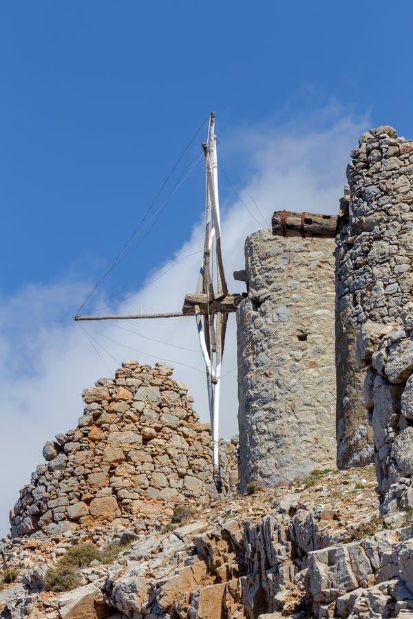Ancient stone windmills Lassithi area, Crete, Greece. Ancient, historic, famous, dilapidated stone windmills on a sunny day Lassithi area, island Crete, Greece stock photo