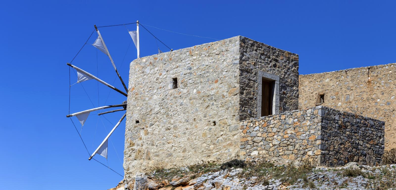Ancient stone windmills Lassithi area, island Crete, Greece. Ancient, historic, famous, dilapidated stone windmills on a sunny day Lassithi area, island Crete stock photo