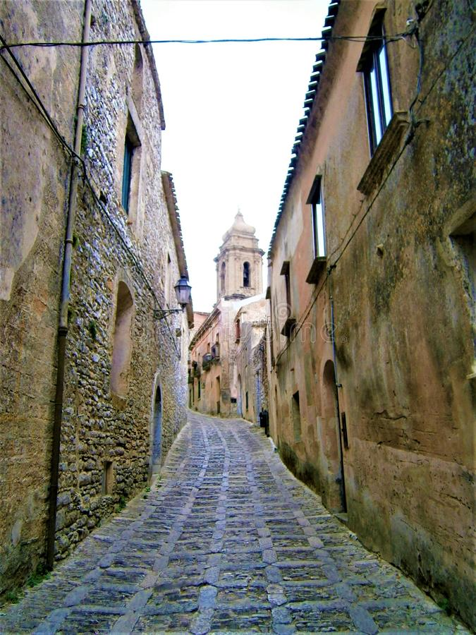 Ancient historic street in Erice town, Sicily region Italy. Time, beauty and history. Fascinating way, splenid path, elegant alley, vintage mood, timeless royalty free stock images