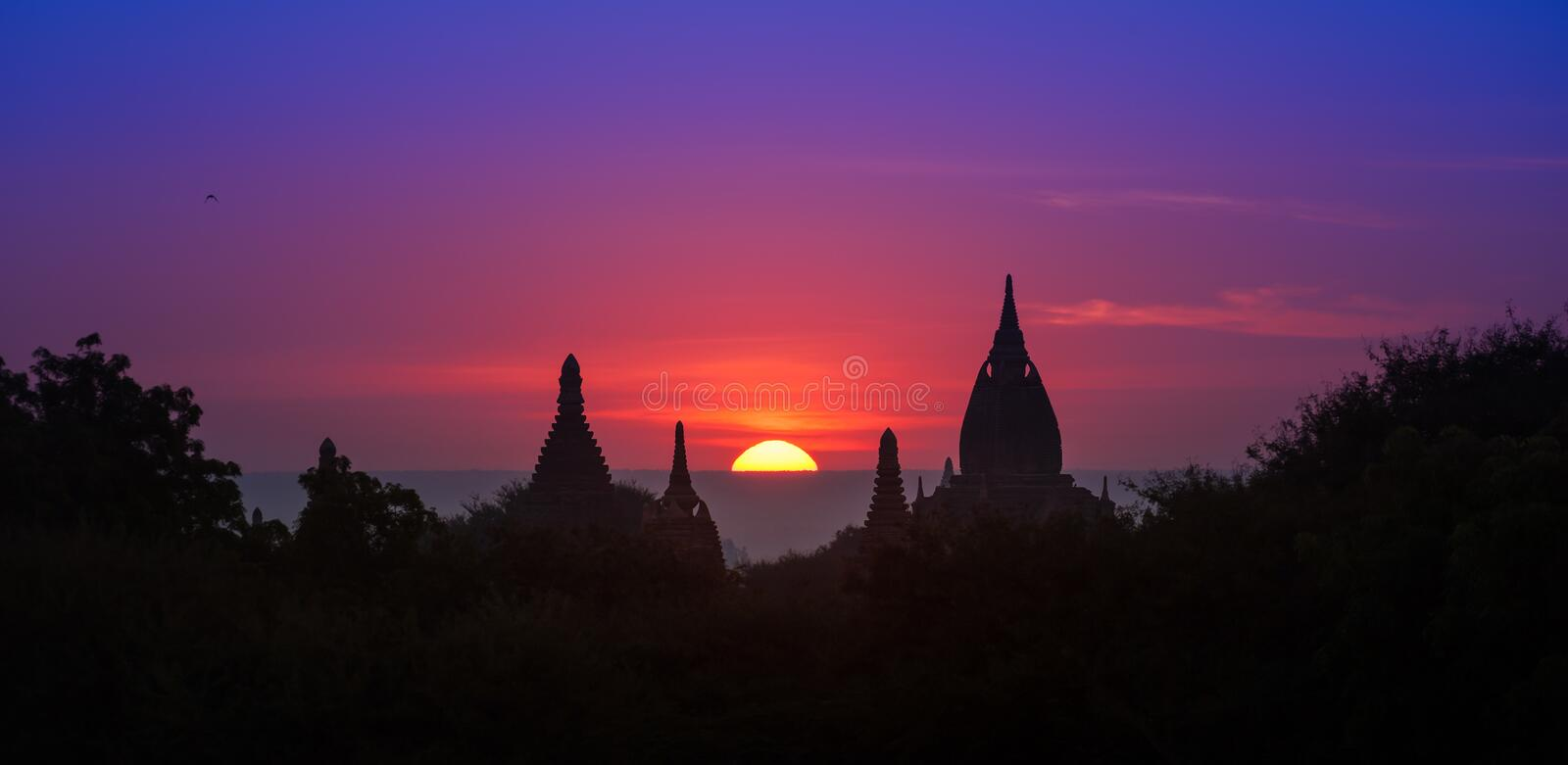 Ancient historical site Bagan in Myanmar at majestic sunset royalty free stock photos