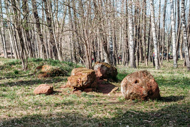 Ancient historical stones lie in Park. Ancient historical stones lie in the Park royalty free stock image