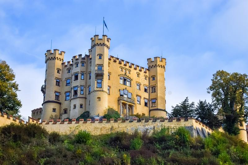 An ancient Hohenschwangau Castle under the morning sunlight in Bavaria with blue sky. An ancient Hohenschwangau Castle under the morning sunlight in Bavaria royalty free stock image