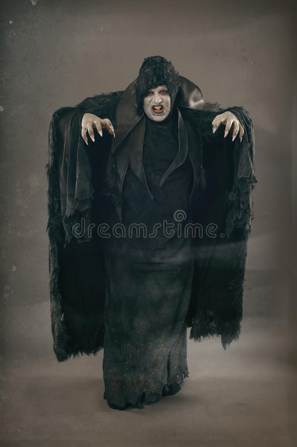Ancient horror mutant vampire with large scary nails. Medieval f royalty free stock photos