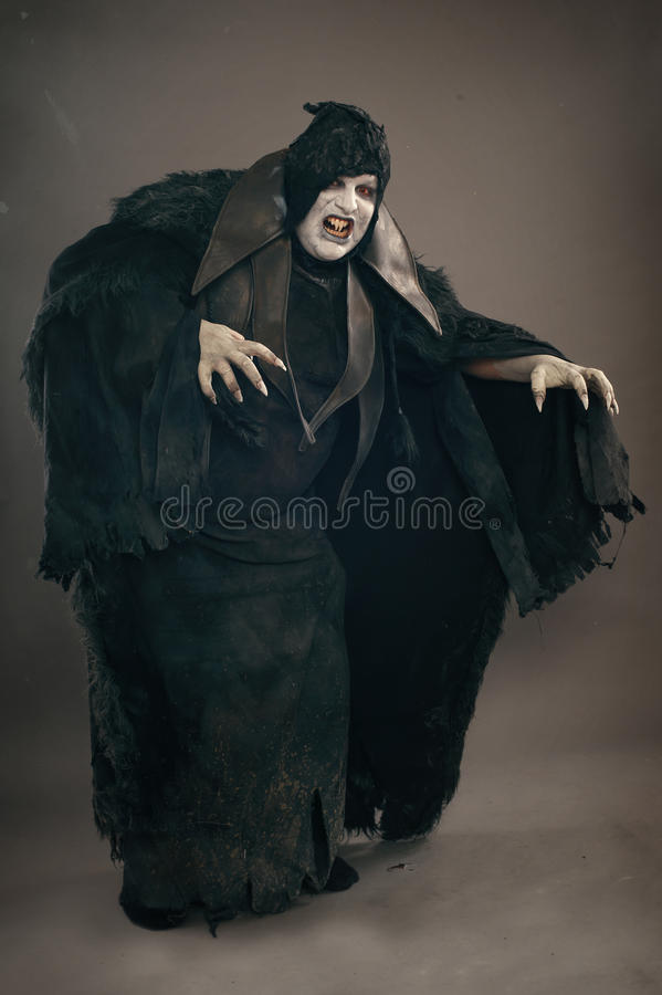 Ancient horror mutant vampire with large scary nails. Medieval f stock photos