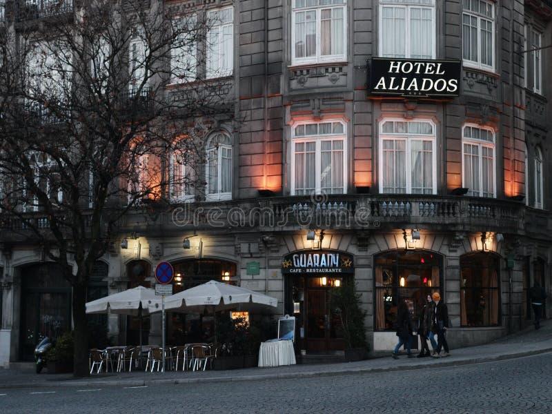 Ancient Hotel Aliados Porto. Historic architecture in Aliados avenue with café Guarani and Hotel Aliados royalty free stock photography