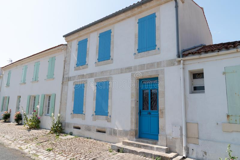 Ancient house white wall and colors shutter in Ile d`Aix in France island. An ancient house white wall and colors shutter in Ile d`Aix in France island stock image