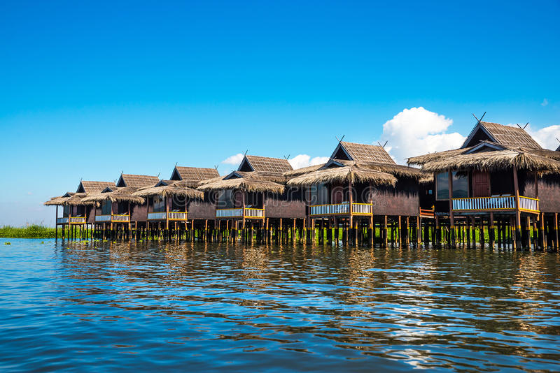 Ancient houses and their reflection in the water on the Inle Lake. Myanmar royalty free stock images