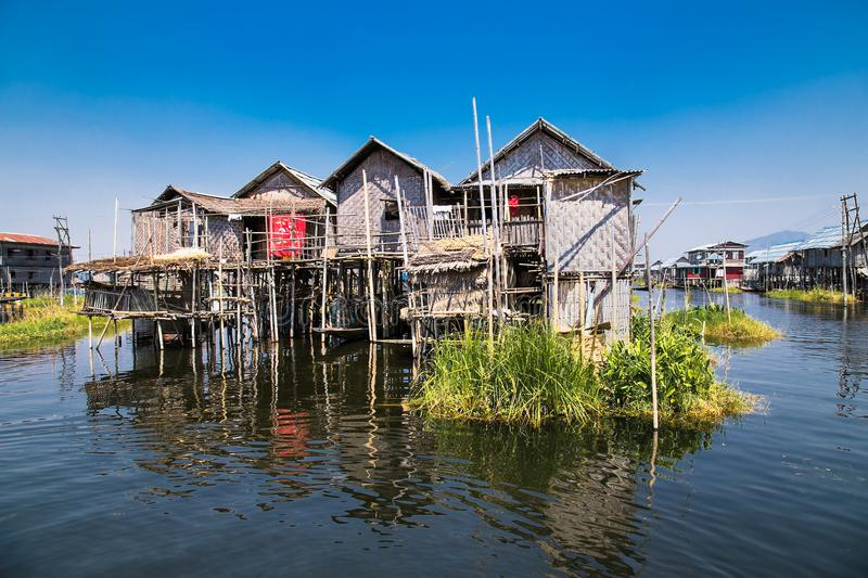 Ancient houses and their reflection in the water on the Inle Lake, Myanmar royalty free stock photo