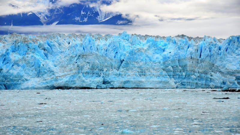 Hubbard Glacier, Yukon, Alaska. Ancient Hubbard Glacier on Pacific West Coast with mountain backdrop, Yukon, Alaska, USA stock images