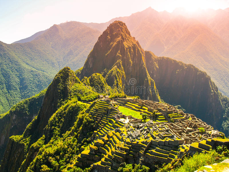 Ancient Inca City of Machu Picchu illuminated by sun. Ruins of Incan Lost city in Peruvian jungle. UNESCO World Heritage royalty free stock image