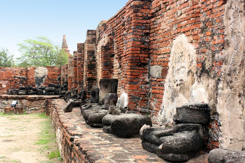 Ancient incomplete sculptures of Buddha in temple ruins. Ayutthaya, Thailand. stock photography