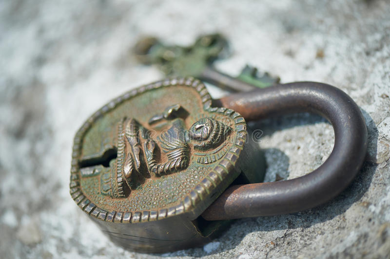 Ancient Indian key lock, green with age royalty free stock images