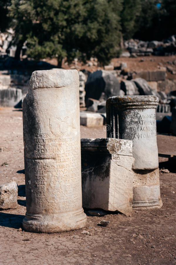Ancient inscriptions carved in columns royalty free stock photo