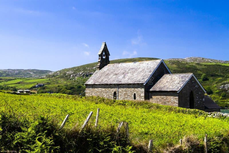 Ancient Irish church in blue sky stock photos