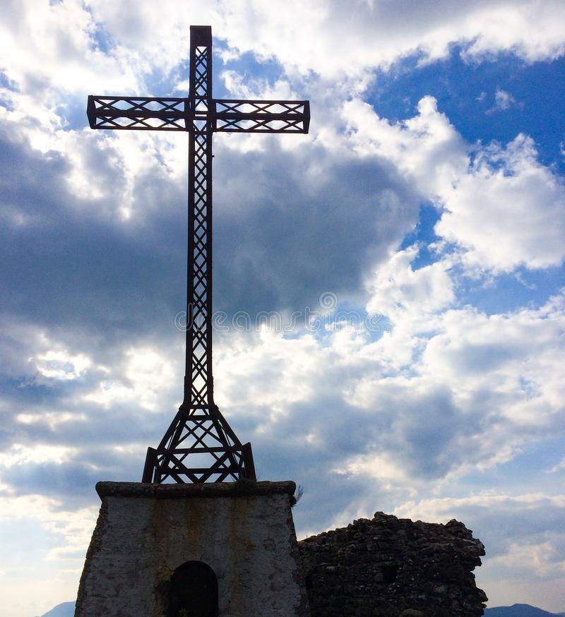 Ancient Iron Cross Under A Blue Cloudy Sky. Ancient Iron Cross Under A Blue Cloudy royalty free stock photo