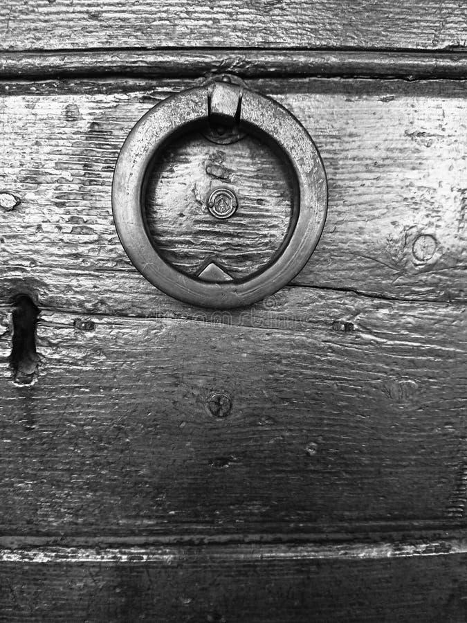 Ancient Iron Door Handle In Black & White stock image