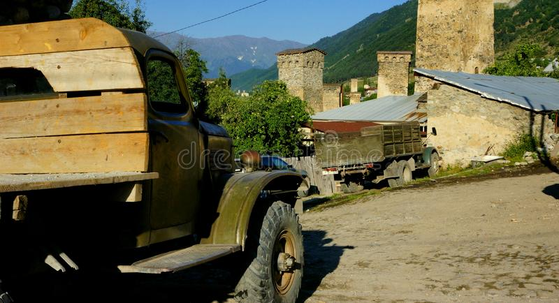 Abandoned trucks and ancient stone towers of Georgia. stock photo