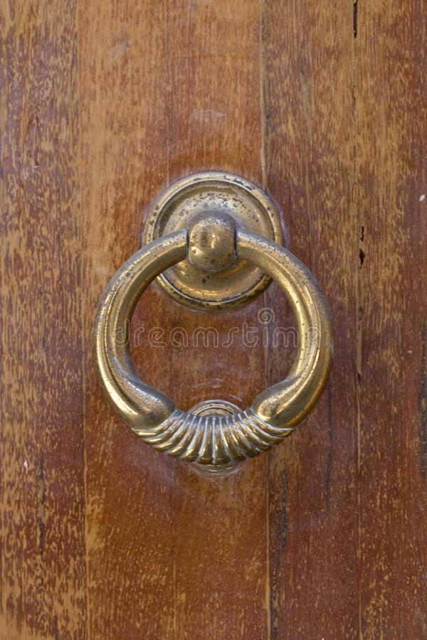 Ancient italian door handle royalty free stock photos