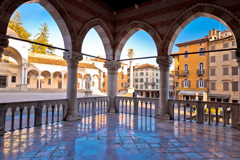 Ancient Italian square arches and architecture in town of Udine. Piazza della Liberta square, Friuli Venezia Giulia region of Italy stock image