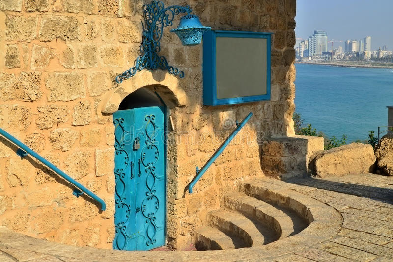 Ancient Jaffa Israel. Stone building with a blue door and a view of the sea and tel Aviv stock photography
