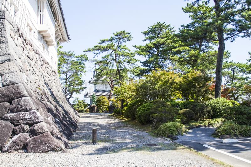 Ancient Japanese castle and trees stock photography